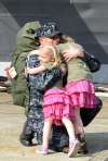 Officer Marc De St. Aubin Hugs His Daughters