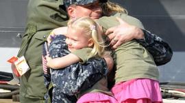 Officer Marc De St. Aubin Hugs His Daughters