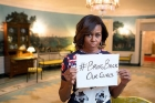 Michelle Obama Holds Up Sign For Chibok Girls