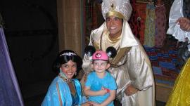 Princess Jasmine and Aladdin Take Photo with Girl