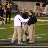 Tim Beckman Stands with Other Coaches