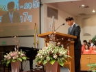 Rev. Sam Shin led a largely Korean-speaking crowd of 400 in prayer to open a worship service after a world education missions conference at Young Nak Presbyterian Church on February 1, 2018. Shin led
