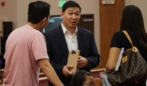 (Photo : )Pastor Andrew Park speaks  with hismembers of his congregation