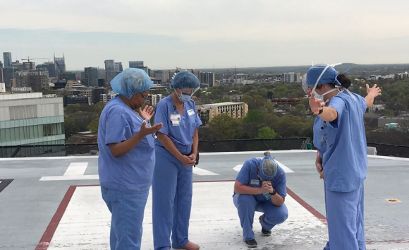 Angela Gleaves and her fellow nurses praying on the rooftop