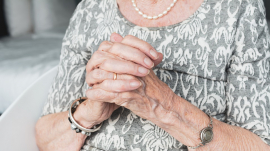 An Old woman holds her hands. This picture isn't related with this article.