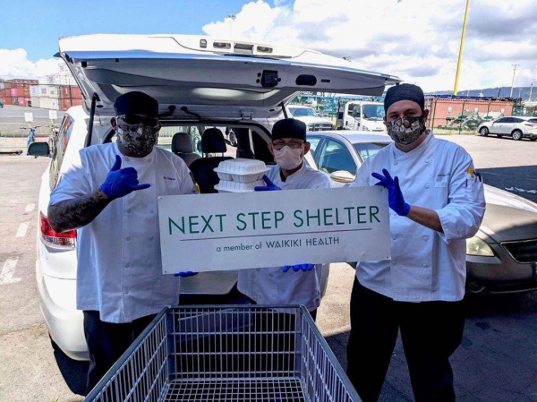 Hawaii Baptist Academy chefs (left to right) BJ Delima, Placer Dayang and Jensen Manuel deliver meals to Next Step Shelter in Honolulu.