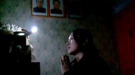N.Korea Woman Praying