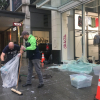 Hundreds of volunteers banded together to start the daunting task of cleaning up the extensive damage from Saturday night's riots and looting in downtown Seattle.