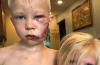 Brave young boy saves little sister from dog attack.