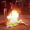 Protesters burn bible in Portland
