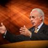 Pastor John MacArthur giving a sermon to his congregation