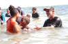 People gather for Calvary Chapel Church's annual outdoor baptism at Newport Beach's Corona Del Mar State Beach on Saturday, September 12, 2020