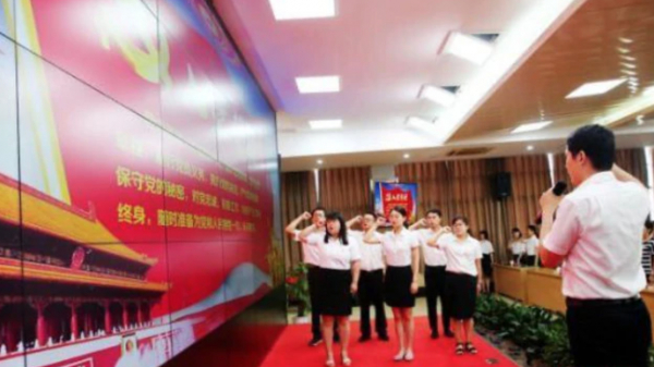 Chinese Teachers swearing allegiance to the Communist Party.