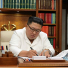 Kim Jong Un signs agreement to ease tensions