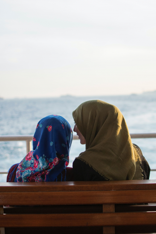 (Picture: Two muslim females sitting on a bench.) Two muslim females sitting on a bench.