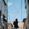 Woman walking with her baby in the streets of Bogota, Columbia.