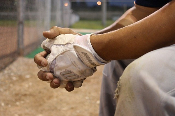 Baseball player's hands in prayer