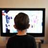 Child watching shows on TV