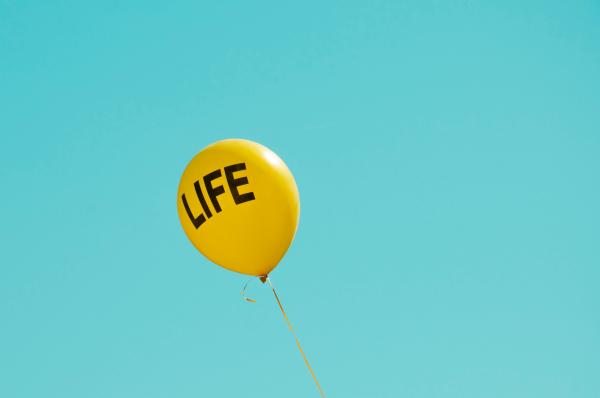 yellow 'Life' printed balloon