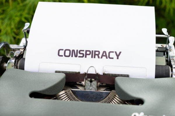 "The word ""conspiracy"" typewritten on a piece of paper"