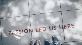"""Passion led us here"" written on floor"