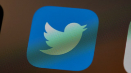 Twitter logo as seen on an iPhone
