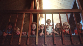 Children Sitting on a Staircase