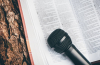 Bible and a microphone
