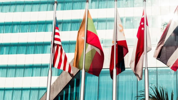 Myanmar's flag along with others outside a building in the country