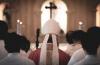 Catholic priest proceeding to the altar