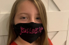 "Lydia Booth and her ""Jesus Loves Me"" face mask."