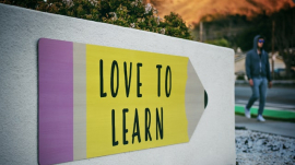 """""""Love to Learn"""" signage outside school"""