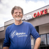 Masterpiece Cakeshop's Jack Philips in front of his store