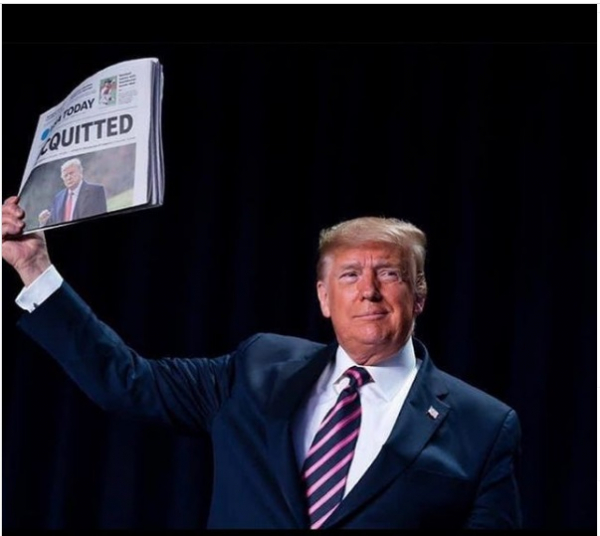 Former President Donald J. Trump holding newspaper saying he's acquitted