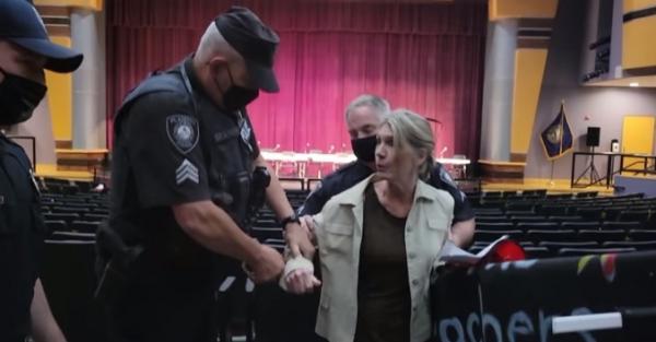 Sgt. Alec Porter arresting teacher Kate Bossi for not wearing a mask