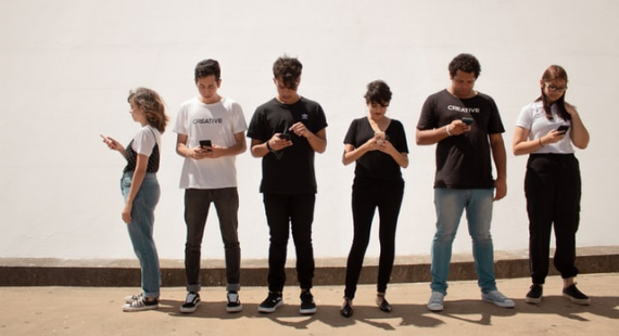 young people with their faces buried on their smartphones
