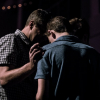 Minister praying for a man in church