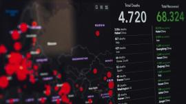 COVID statistics shown on screen