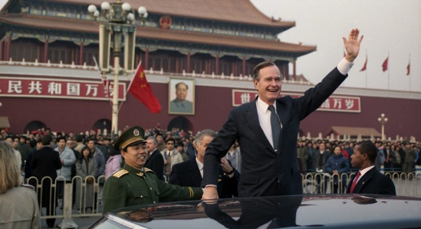 Former President George H. W. Bush waves to crowds in Beijing, February 1989