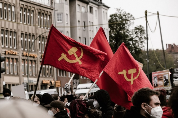 People waving communist flags on the streets
