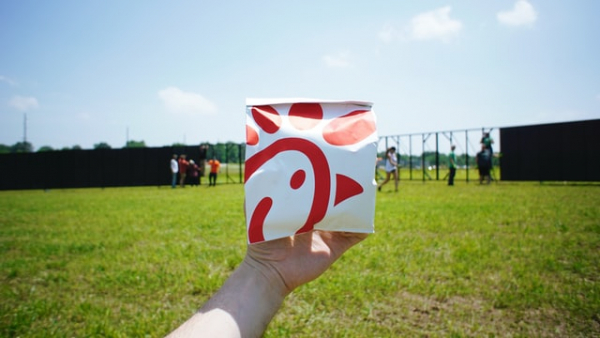 Person holding pack of food from Chick-fil-A
