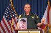 Polk County Sheriff Grady Judd holding photo of disgraced youth pastor Andrew Weaver