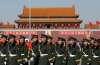 Members of China's People's Liberation Army (PLA) walk past the Tiananmen Gate in Beijing, China.