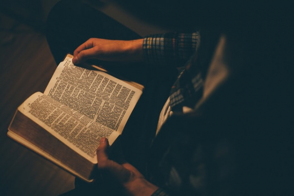Reading Bible in dim light