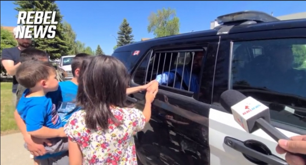 Pastor Tim Stephens being arrested as his wife and kids watch in tears