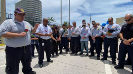 Miami-Dade Chaplain & firefighters praying