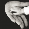 Baby and father's hand