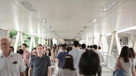 crowded foot bridge at Hong Kong airport