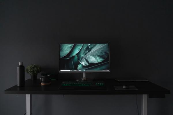 computer screen display monitor dark workstation table