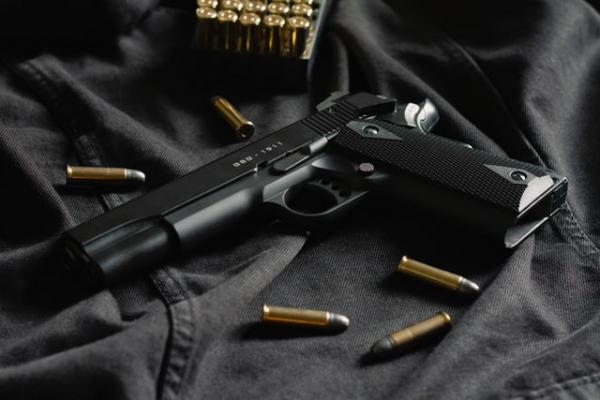 handgun with bullets around